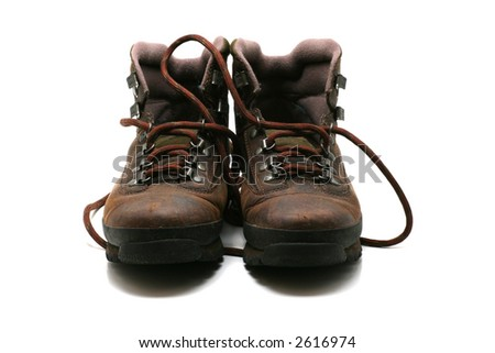 used hiking boots, front view, on white background. - stock photo