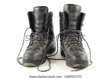 Used hiking boots, isolated - stock photo