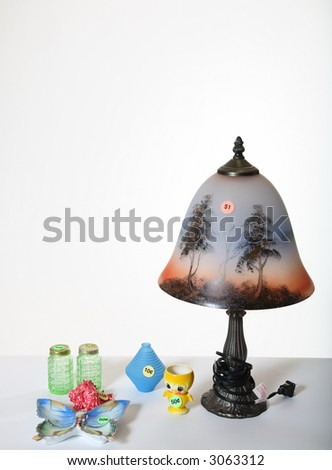 Used items displayed for sale at a garage sale. - stock photo