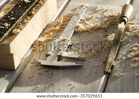 used joiner tool in different positions on wooden table