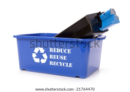 Used laser printer cartridge in blue recycle bin over white - stock photo