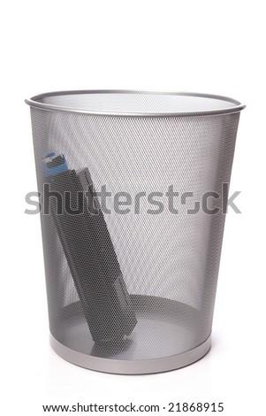 Used laser printer cartridge in metal trash bin over white - stock photo