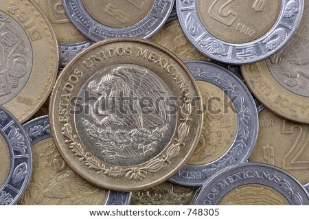Used Mexican coins, all pesos. Focus = the complete coin, left center. 12MP camera, extreme macro. - stock photo