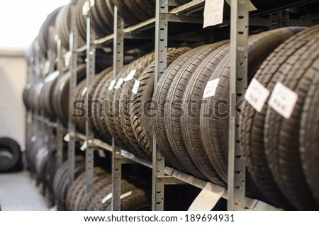 Used old car tires at warehouse. - stock photo