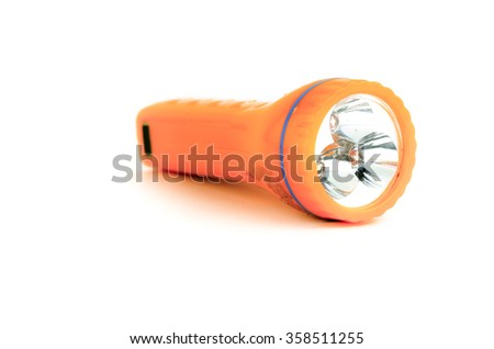 used orange flashlight isolated on white background - stock photo