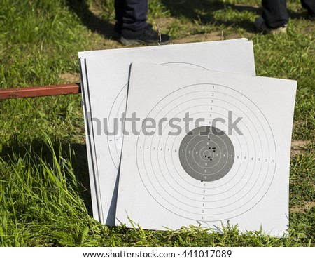 Used paper targets, with some bullet holes. - stock photo