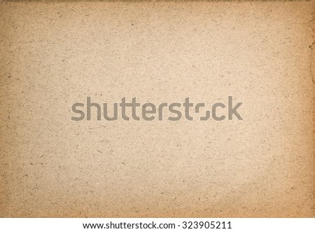 Used paper texture. Vintage cardboard background with vignette - stock photo