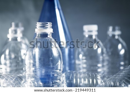 Used plastic bottles destined for the recycle bin or landfill?  - stock photo