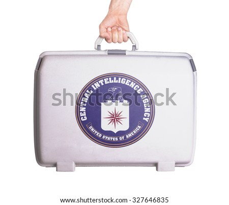 Used plastic suitcase with stains and scratches, printed with flag - CIA - stock photo