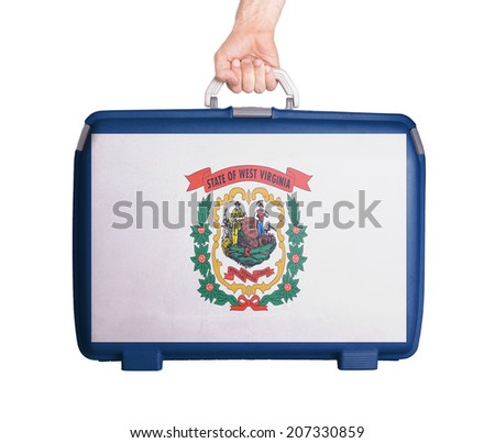 Used plastic suitcase with stains and scratches, printed with flag, West Virginia - stock photo