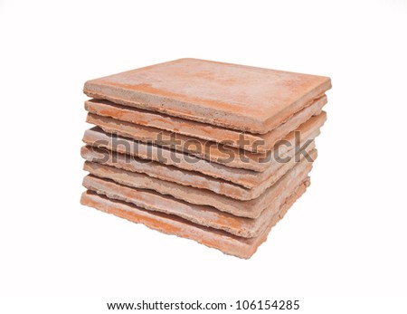Used saltillo tiles isolated - recycled building materials - stock photo