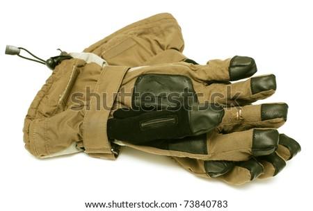 used ski gloves on white background - stock photo