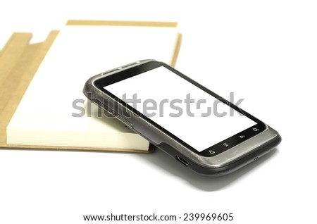 used smart phone with note book on a white background