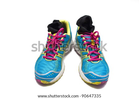 Used sneakers with socks on white background - stock photo