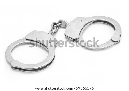 Used steel handcuffs isolated on white background - stock photo