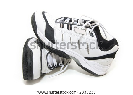 Used Tennis sneakers isolated in white background - stock photo