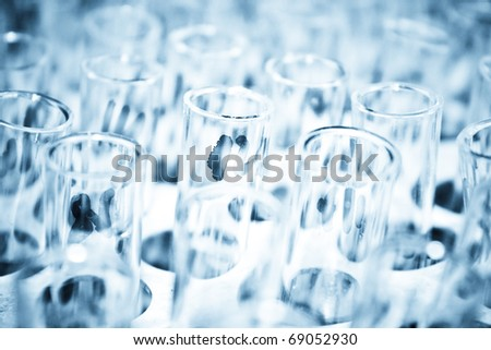 Used test tubes in a row - Selective focus test tube background - stock photo