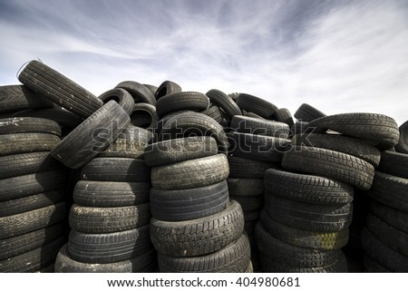 Used Tires Heap - Tyres Pile with Sky