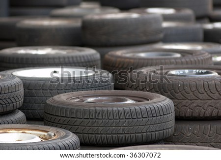 Used tires to buy at the scrapyard - stock photo