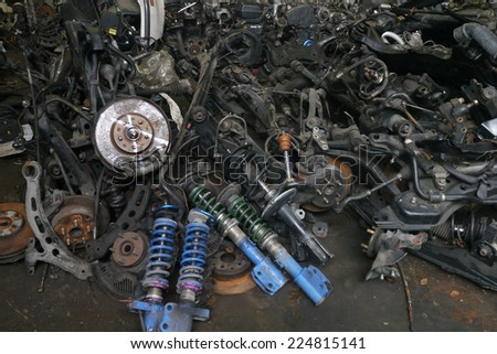 Used Vehicle spare parts, second hand, for sale in garage - stock photo