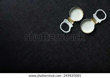 Used water bottle cap pulling type made from aluminum put on the black color leather background represent the beverage containing equipment related - stock photo