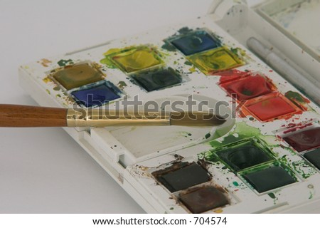 Used water color paint set with paint brush