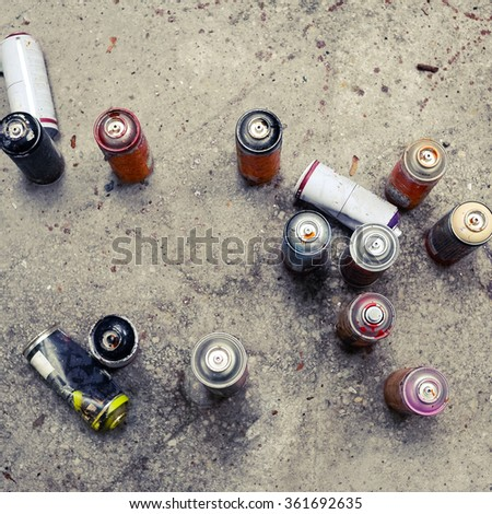 used white graffiti spray cans - stock photo