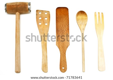 used wooden spatulas and kitchen hammer - stock photo