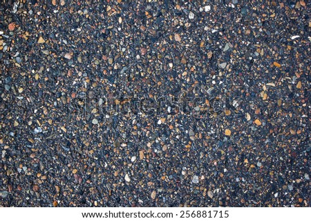 Useful background of wet asphalt texture. - stock photo
