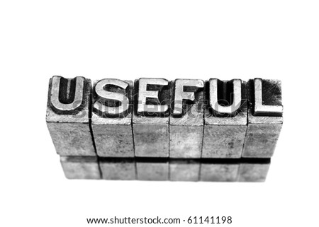 USEFUL written in metallic letters on a white background - stock photo