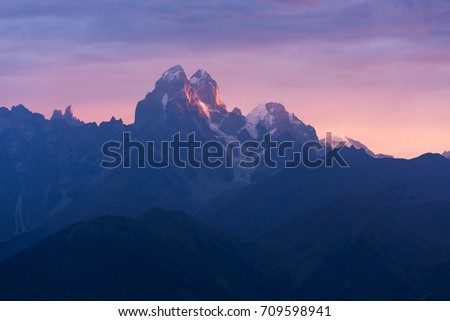 Ushba is the most beautiful mountain in the Caucasus. Zemo Svaneti, Georgia. Colorful dawn with pink clouds