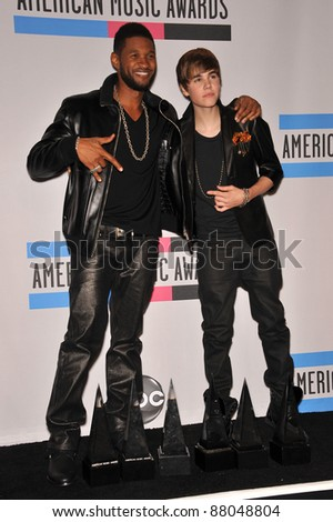 Usher & Justin Bieber (right) at the 2010 American Music Awards at the Nokia Theatre L.A. Live in downtown Los Angeles. November 21, 2010  Los Angeles, CA Picture: Paul Smith / Featureflash - stock photo