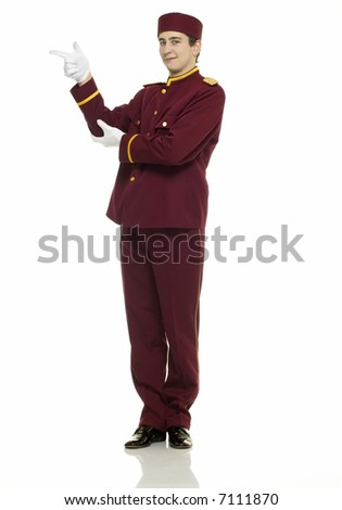 Usher with red uniform and white gloves points at presentation. - stock photo