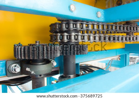 Using a mix of chains and sprockets. - stock photo