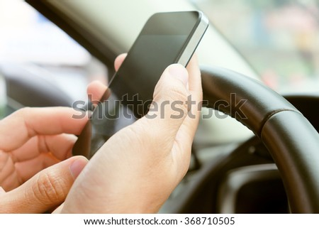 using a mobile phone inside of a car