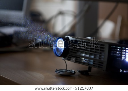 Using a projector at a corporate meeting