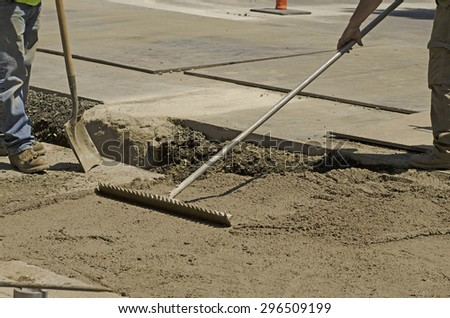Using a special contract slurry to backfill a sanitary sewer pipe installation during a road re-construction project - stock photo