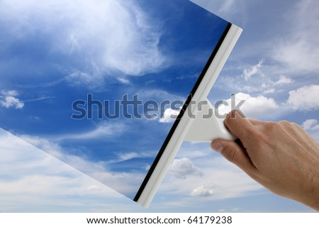 Using a squeegee to clear the blue sky above
