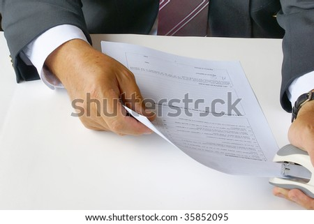 Using a stapler for documents - stock photo