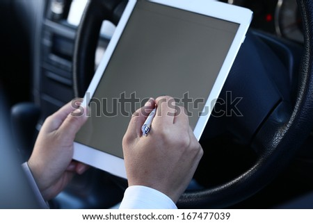 Using a tablet pc - stock photo