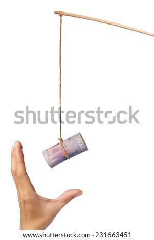 Using Canadian dollar as a bait depicting greed, isolated on white background  - stock photo