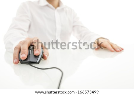 Using computer mouse on white desk. - stock photo