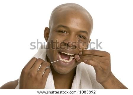Using dental floss - stock photo