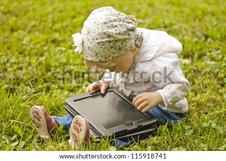 Using digital tablet in nature - stock photo