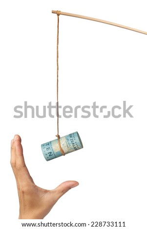 Using New Zealand dollar as a bait with a hand grasping at it, isolated on white background  - stock photo