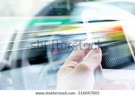 Using smart phone double exposure and blurred view of car on city street