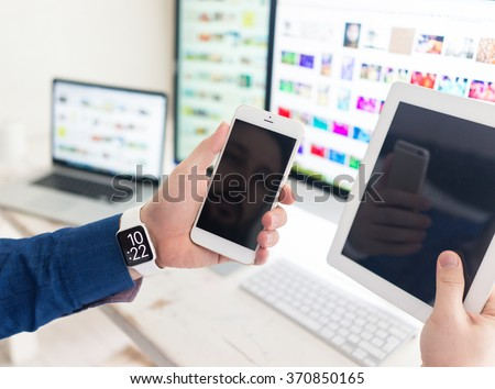 Using smart watch smartphone tablet laptop and computer