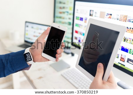 Using smart watch smartphone tablet laptop and computer - stock photo