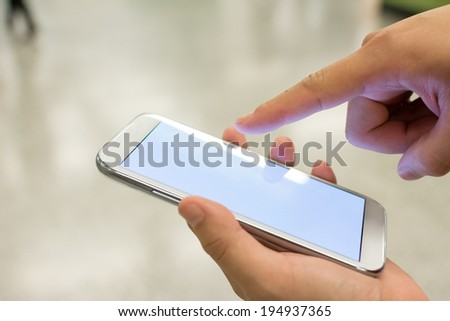 Using smartphone in a market or department store, closeup image. - stock photo