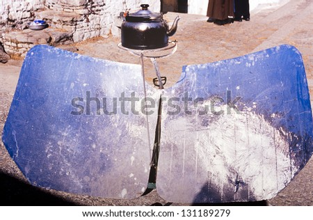 Using solar power via reflection to boil a kettle - stock photo